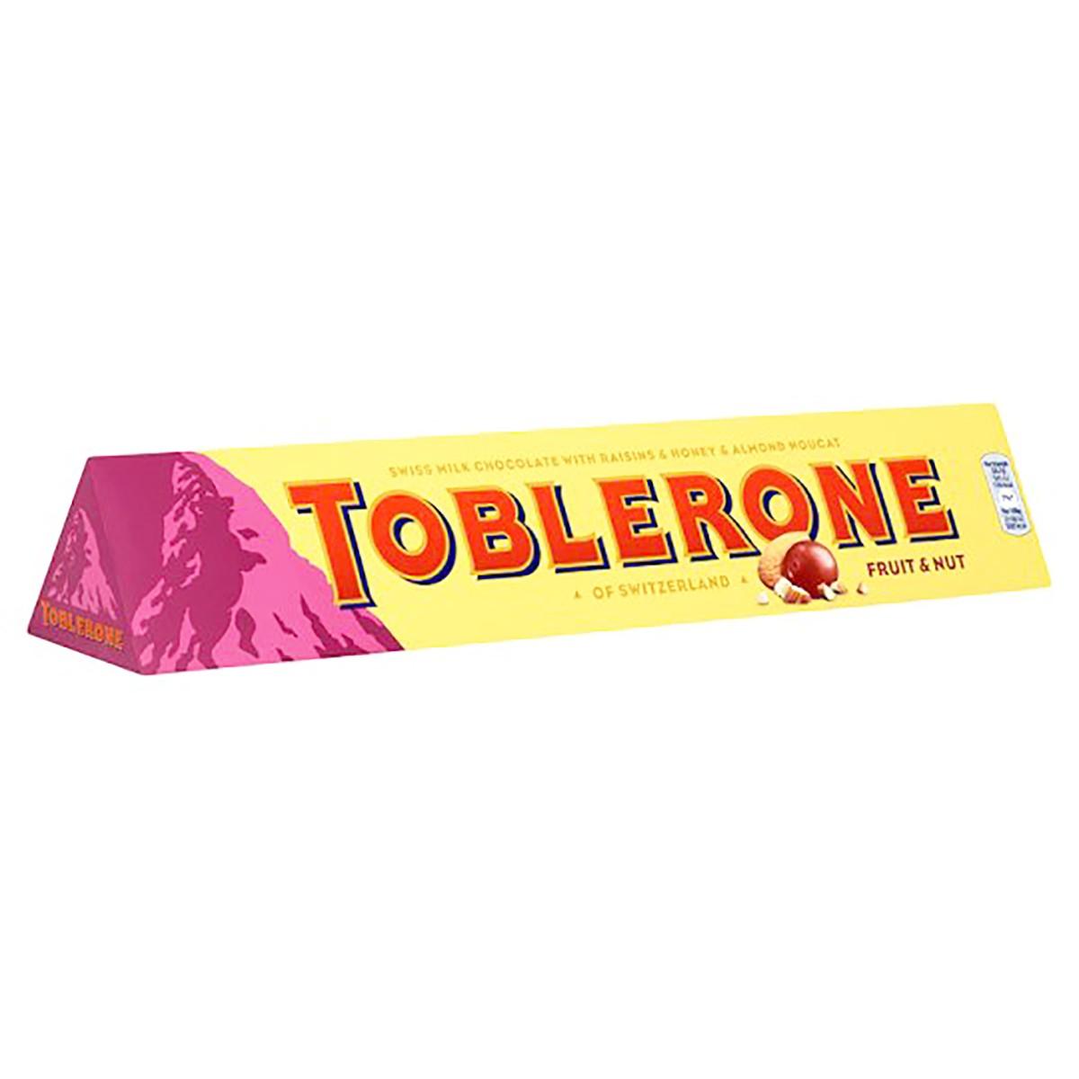 Молочный шоколад Toblerone с изюмом и нугой фото